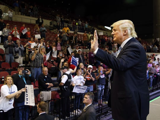 Donald Trump waves to the crowd following a rally on