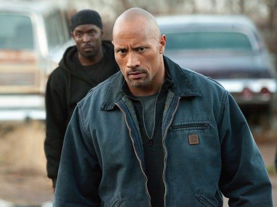 "Dwayne Johnson stars as a dad taking on a drug cartel in ""Snitch."""