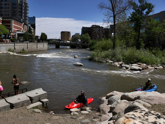 Ben Spillman, right, and Noah Fraser take a break while paddling the Truckee River Whitewater Park in 2016.