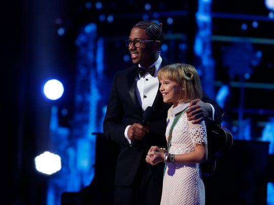 """America's Got Talent"" host Nick Cannon and Grace VanderWaal after her performance on Sept. 13, 2016."