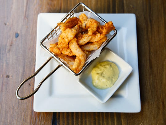 Crispy fried shrimp served with a saffron tartar sauce is one of the bar snacks offered on Catalan's happy hour menu, Oct. 20, 2016.