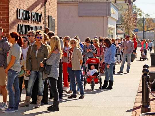 Voters wait in a long line Monday afternoon outside of the Licking County Administration Building on Courthouse Square.