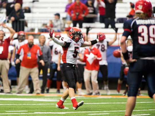 Glens Falls defensive back Quinn Girard celebrates after the Indians stopped a Chenango Forks two-point attempt with less than a minute left in the Class B state title game on Saturday, Nov. 26, 2016.