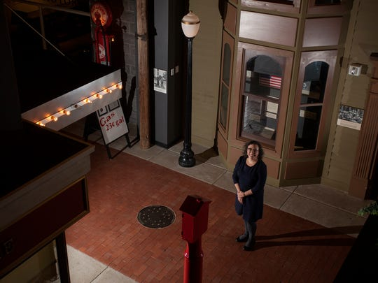 Suzanne Fischer poses for a portrait in an exhibit on 1930s Michigan history on Thursday, Dec. 22, 2016 at the Michigan History Center. Fischer is the new director of the state museum.