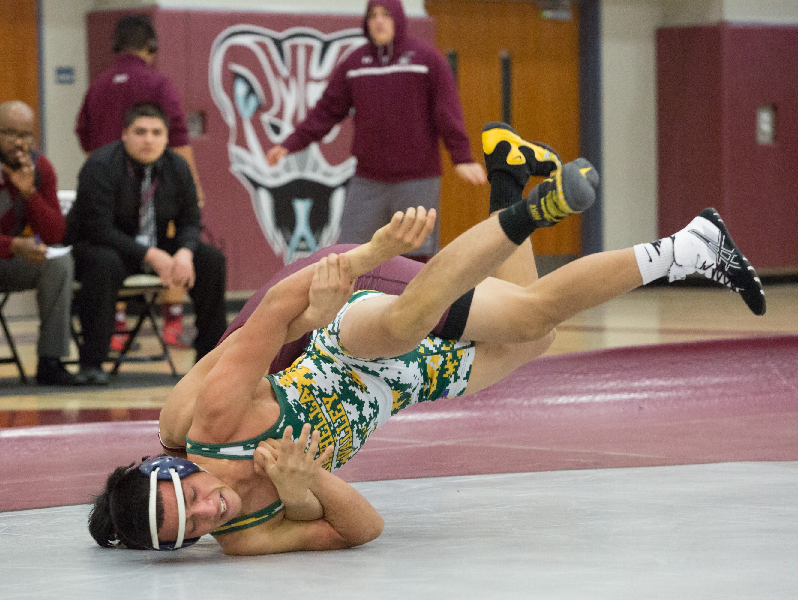 Coachella Valley matches up against Rancho Mirage in the De Anza League wrestling finals, Wednesday, January 25, 2017.