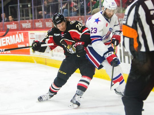 Binghamton Senators right wing Marc Hagel hip-checks Rochester Americans defenseman Tyson Strachan during the second period of Saturday's American Hockey League game in Binghamton. The B-Sens won, 4-3.