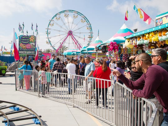 Thousands attend the Riverside County Fair and National Date Festival in Indio, Sunday. Four people were stabbed during an incident in the carnival area Sunday and the attack is still being investigated.
