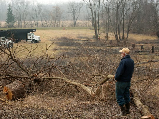 Tod Frolking watches as Russell Tree Experts clear