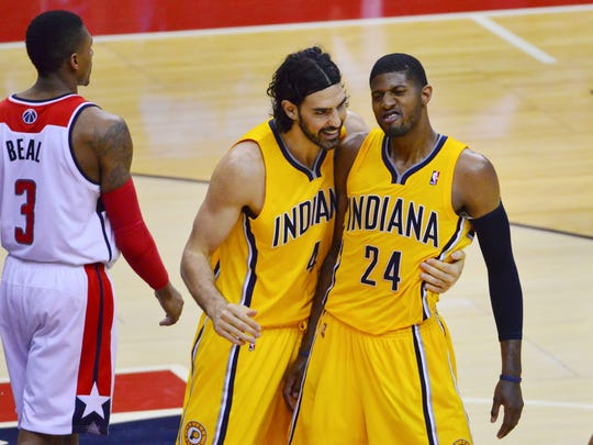 May 11, 2014; Washington, DC, USA; Indiana Pacers forward Luis Scola (4) celebrates with forward Paul George (24) after George's basket during the fourth quarter of game four of the second round of the 2014 NBA Playoffs against the Washington Wizards  at Verizon Center. Indiana Pacers defeated Washington Wizards 95-92. Mandatory Credit: Tommy Gilligan-USA TODAY Sports