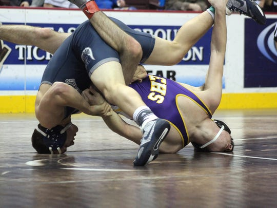 Chambersburg's Drake Brenize, top, tangles with Tyler Mentzer of Ephrata at 152 pounds during the District 3 Class 3A wrestling tournament on Thursday, Feb. 23, at Giant Center.