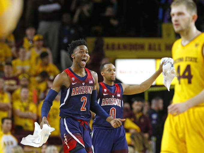 Arizona Wildcats guard Kobi Simmons (2) and guard Parker