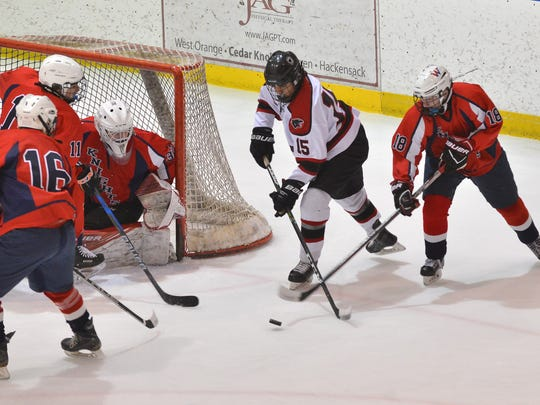 Glen Rock's Jake Kinney (15) looking to shoot in the Public B State Hockey Final this month.