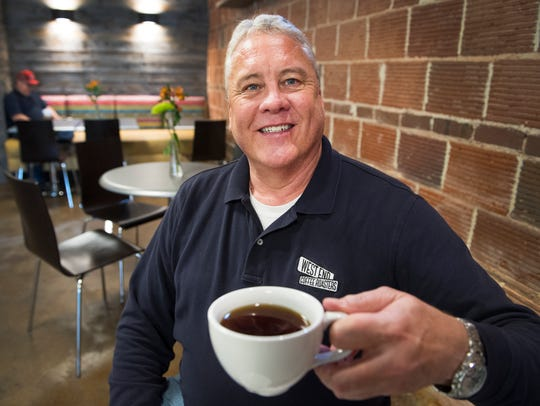 John Brown, owner of West End Coffee, on Tuesday, March