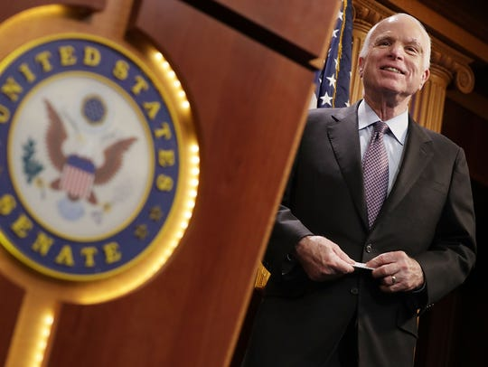 Sen. John McCain takes part in a news conference on