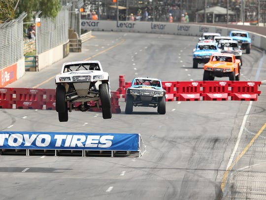 Drivers race in the SPEED Energy Stadium Super Trucks