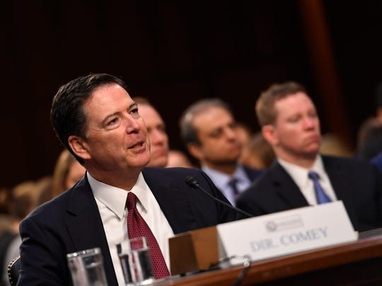 Former FBI Director James Comey testifies in front of the Senate Intelligence Committee in Washington.