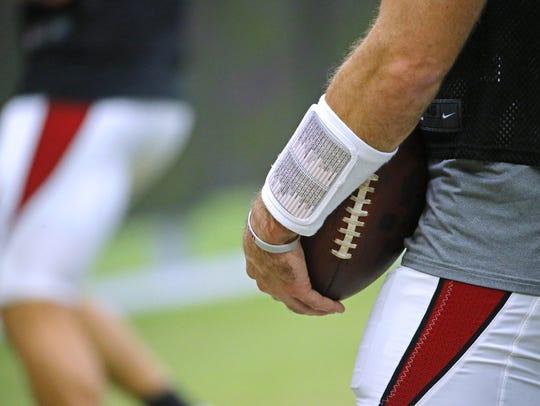 A Cardinals quarterback wristband seen during training