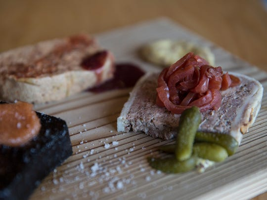 The Terrine Sampler, of three house-made terrine and accompaniments, at the Cheese Bar, on Thursday, Aug. 24, 2017, in Des Moines.