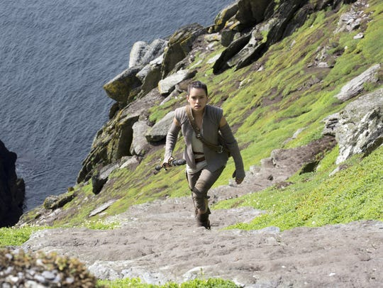 Rey (Daisy Ridley) climbs the Jedi steps to meet an