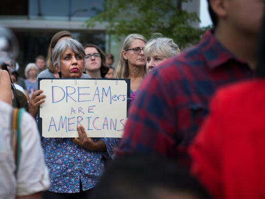 Chirinjev Peterson attends a vigil for Dreamers in response to Trump's announcement to end DACA outside of the Peace Center in Greenville on Tuesday, September 5, 2017.