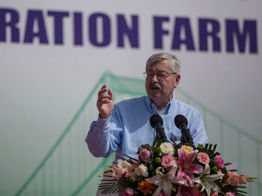 Ambassador Terry Branstad gives a speech during the