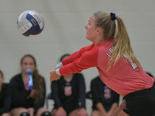 Morgan Thiel (1) of Lourdes gets a dig in the first set against Valley Christian on Tuesday.