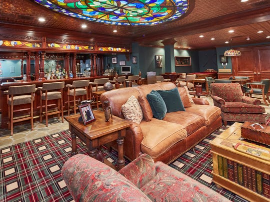 The lower level of Stonehouse offers an English-style pub with pieces imported from Manchester, England, complete with stained glass ceiling.