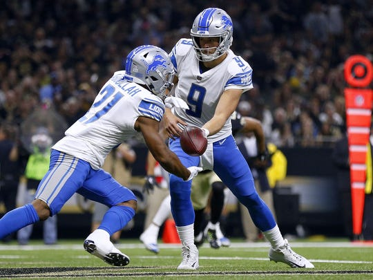 Matthew Stafford hands the ball to Ameer Abdullah during the first half against the Saints at the Mercedes-Benz Superdome on Oct. 15, 2017 in New Orleans.