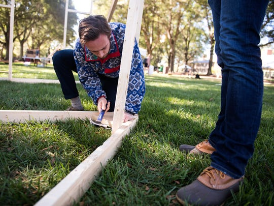 Furman Beta Theta Pi student Frankie Pinney helps construct a float as he and his fraternity brothers prepare for homecoming at Furman University on Thursday, Oct. 19, 2017.