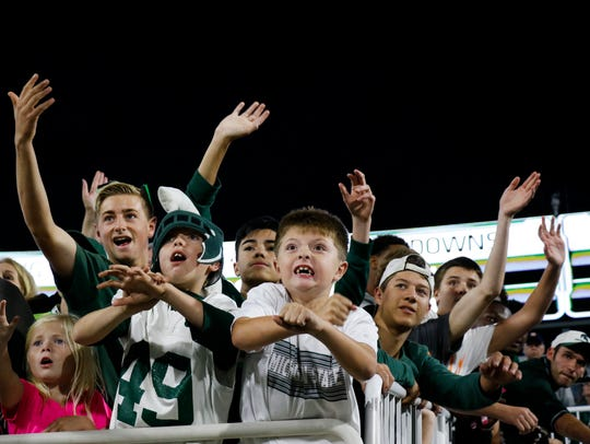 Young MSU football fans cheer Saturday, Oct. 21, 2017,