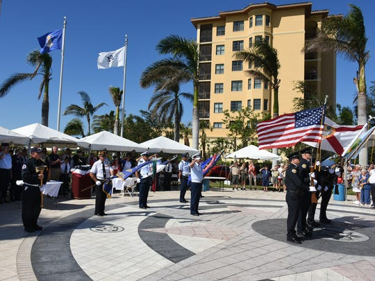 The veterans' Color Guard and MIPD Honor Guard present the colors on Nov. 11, 2017. Marco Island commemorated Veterans Day Saturday at Veterans' Community Park, with speeches, flags and patriotic music.