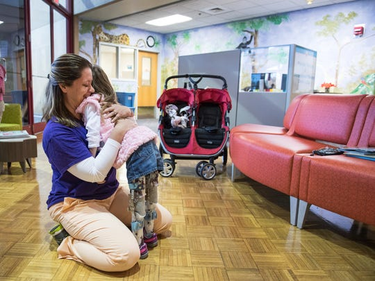 Brayden Dame, 6, hugs Dr. Susanne Cherry at Shriners Hospitals for Children in Greenville on Friday, November 17, 2017. Dame has Arthrogryposis Multiplex Congenita and just started walking on her own in September.