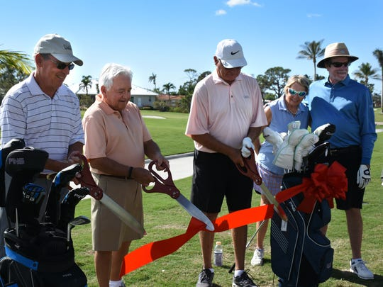 Club president Bob Boardman, and past presidents Bob Dorretti and Rene Champagne cut the ribbon at a celebratory luncheon. The Island Country Club golf course reopened Dec. 1 after a $6 million renovation interrupted by Hurricane Irma.