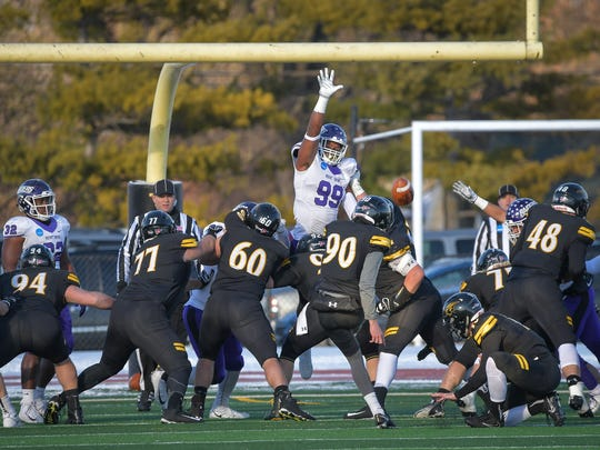 Turner Geisthardt (90) of the Titans kicks a field goal in the third quarter. The University of Wisconsin-Oshkosh Titans hosted the Mount Union Raiders Saturday afternoon in an NCAA Division III national semifinal on J.J. Keller Field at Titan Stadium.