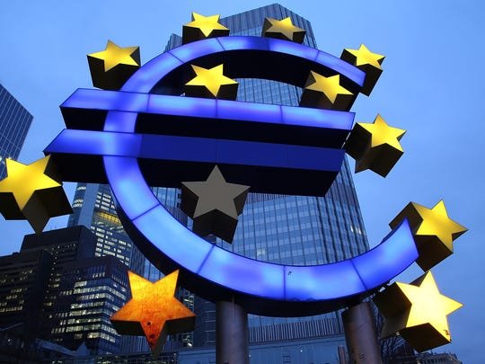 The symbol of the Euro, the currency of the Eurozone, stands illuminated in Frankfurt, Germany, in this 2015 photo.
