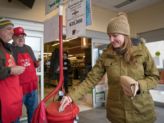 Lucy Hoh makes a donation on Saturday, Dec. 23, 2017, at the Pick 'n' Save in Oshkosh. Helen Lord Burr collected donations for The Salvation Army Red Kettle drive every Christmas Eve for over 40 years. She died in September, so her family members are carrying on the tradition in the memory of all she did for the Oshkosh community.