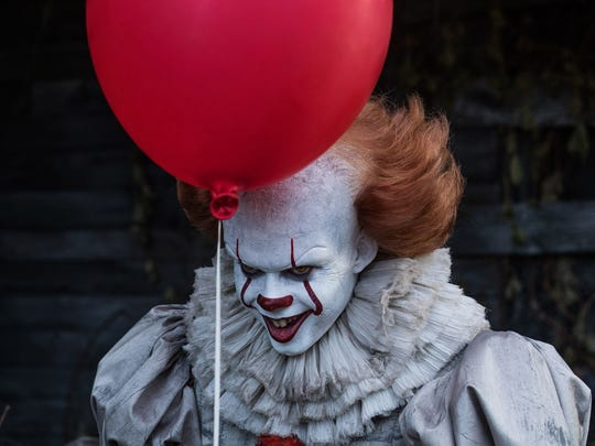 "The evil clown Pennywise (Bill Skarsgård) threatens the kids of Derry in ""It."""
