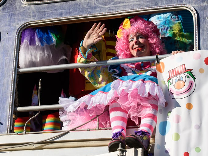 APS volunteer clowns ride aboard Walter the bus at