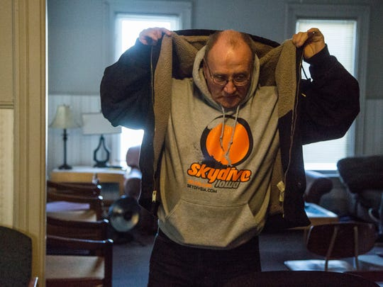 "Barry Freed, president of the Harbor of Hope board of directors and former resident of the recovery house pulls on his coat before leaving on Wednesday, Jan. 3, 2017, in Des Moines. ""I've just been given a life today I feel pretty undeserving of most of the time, to be a member of society, to be a member of this house."" said Freed."