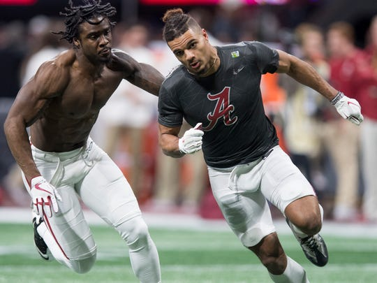 Alabama defensive back Tony Brown, left, and defensive back Minkah Fitzpatrick warm up before the College Football Playoff National Championship Game in the Mercedes Benz Stadium in Atlanta, Ga., on Monday January 8, 2018. (Mickey Welsh / Montgomery Advertiser)