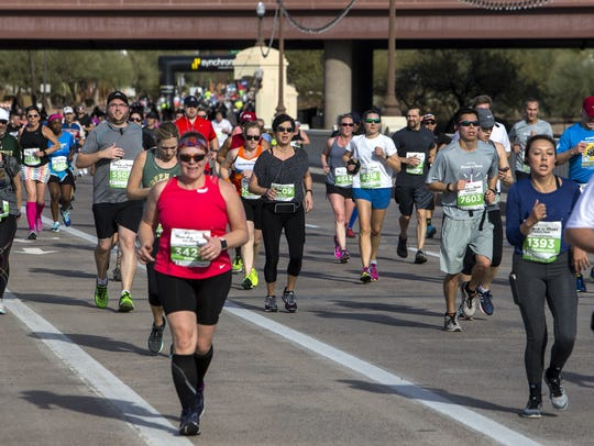 Runners cross the Mill Avenue Bridge during the Synchrony