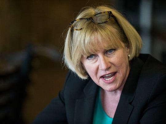 Cathy Glasson, democratic candidate for governor, holds