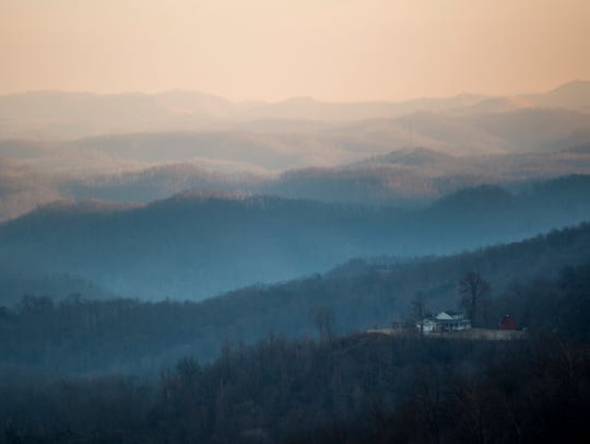An early morning mist envelopes the Appalachian mountains