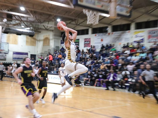 Carencro's Jatrell Marks (20) goes for two points as the Carencro Bears take on the Westgate Tigers in a boys high school basketball game Tuesday Feb. 6, 2018.