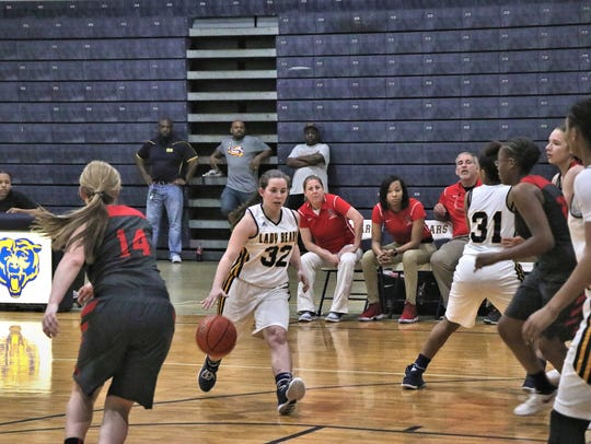 Carencro's Bailey Benoit (32) dribbles the ball down