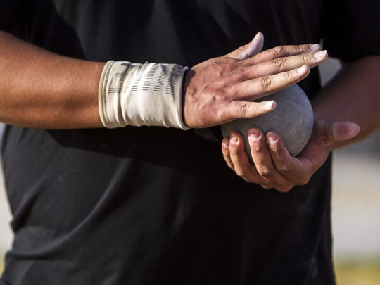 Desert Edge's Tyson Jones holds a shot put ball in