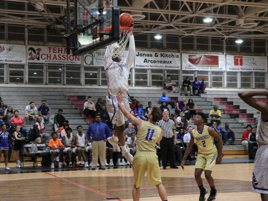 Travante Sam with the slam dunk for David Thibodaux in Monday's regional playoff victory over Vandebilt Catholic.