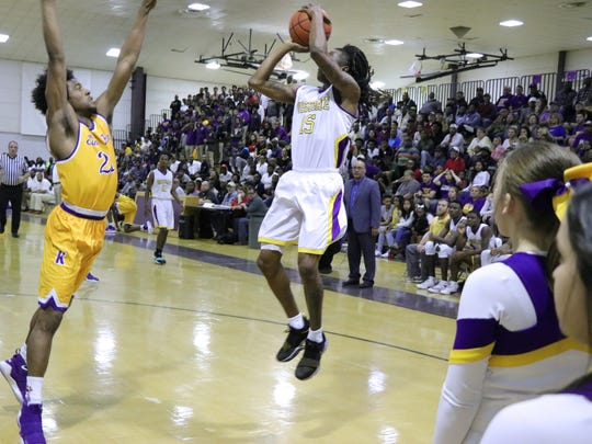 Westgate's Keyvie Eddie (15) goes for a jump shot as the Tigers host the Edna Karr Cougars in an LHSAA Class 4A quarterfinal match Friday, March 2, 2018.