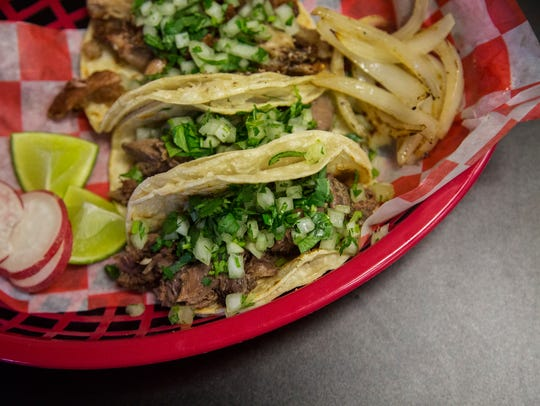 The cabeza, tripa and lengua tacos at Tacos La Familia