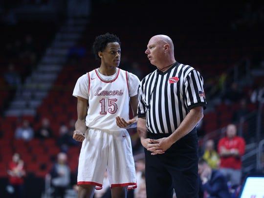 North Scott's Corvon Seales talks to a referee about